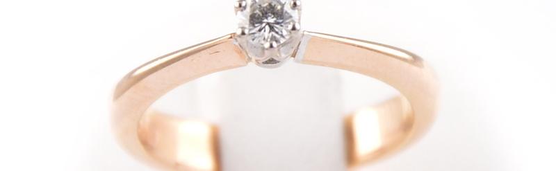 Solitaire or rose et blanc. Diamant de 17 pts. Prix 979 euros